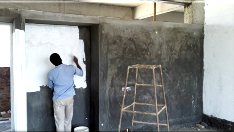 The plastering of interior walls